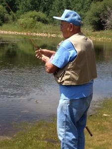 Columbus fishing at his 80th birthday celebration.