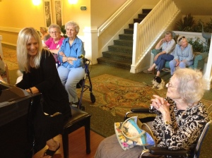 Kerri playing for her mom and the other ladies.