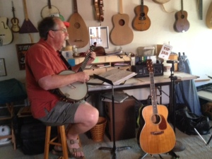 JIm Marsh of the band, Mom's Chili Boys, tuning up for rehearsal.